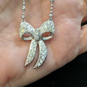 Cookie Lee silver and rhinestone bow necklace